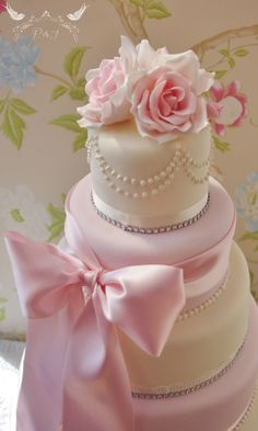 Romeo & Juliet Cakes - Francesca ivory and pink wedding cake with pink sugar roses, pearl necklace, large pink bowand diamantes
