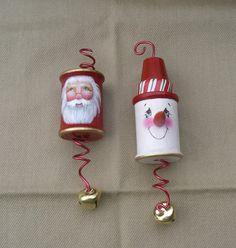 Wooden thread spool ornaments.