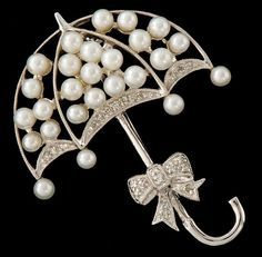 A Gold, Pearl and Diamond Umbrella Brooch - Length 1 ¼ in. - white gold brooch in the form of an umbrella, set with pearls and accented with round cut diamonds, total estimated diamond weight ct; Pearl Jewelry, Antique Jewelry, Jewelry Box, Vintage Jewelry, Fine Jewelry, Jewellery, Bijoux Art Deco, Art Nouveau Jewelry, Pearl And Lace