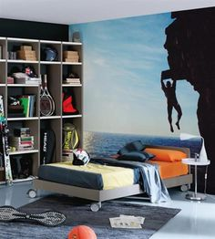 Climbing theme bedroom ideal for a teenage boy, fab wall mural and love the wheels on the bed, would make vaccuming easy