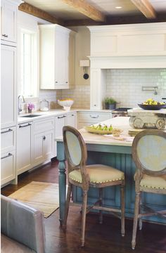 White kitchen with French blue island and antique chairs. #white #kitchen #design