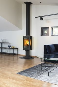 """The F 373 Advance is a large wood burner characterised by its modern design where the combustion chamber sits on a pedestal. This model is a re-design of the only in the world to have won the prestigious, international """"Red dot design award: best of the Wooden Fireplace, Home Fireplace, Fireplaces, Modern Wood Burning Stoves, Wood Stoves, Living Spaces, Living Room, Log Burner, Cabin Design"""