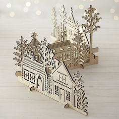 Our charming village is laser-cut in realistic detail, easily assembled into a dimensional, freestanding conversation piece. This cluster of homes, churches and trees can be paired with our laser-cut animals and trees for a full decorative statement.