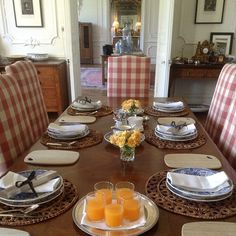 Buffalo check dining room chairs around a table set for breakfast - Chateau Bosgouet, Normandy