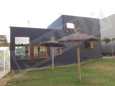 Fachada exterior restaurante con chapa de acero minionda color negro dextar