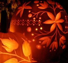 Halloween pumpkin carving with a floral design.