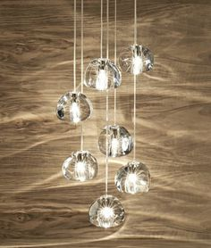 Beautiful Terzani Mizu 水7-Light Suspension: Inspired by the tranquil and mesmerizing ligh refractions created by water, Mizu is a new, customizable pendant light from Terzani
