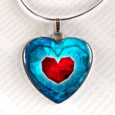 This is amazing!  Piece of Heart Pendant Legend of Zelda Inspired by PendantLab