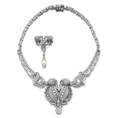 Diamond necklace and a natural pearl and diamond brooch, 1950s The necklace of scroll design, set with circular-, square-, single-cut and baguette diamonds, the detachable centre can be worn as a double clip brooch, length approximately 440mm, the brooch also of scroll design similarly set, suspending a drop shaped natural pearl measuring approximately 10.55 x 10.60 x 14.50mm, can be worn at the centre of the necklace, fitted case.