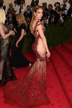 Jennifer Lopez in a revealing red dress is one of the Met Gala's most memorable looks of all time.