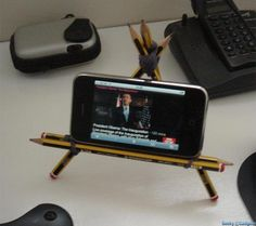 Pencils iPhone Stand: Make a cool tripod iPhone stand using 5 pencils and some rubber bands.