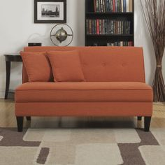 The Portfolio Engle armless loveseat features a button tufted back and two 18 inch throw pillows. The loveseat is covered in a durable linen-look fabric and features a handy lock system for easy assembly.