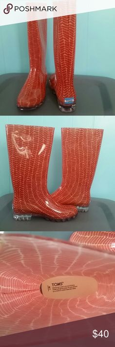 """NWOT TOMS Rainboat Never worn. Very light and comfy plastic rainboot. Slip resistant. Color is more like orangy red with that herringbone effect-kinda brightens a rainy day ;) Measurements: Heel- about 1"""", bottom to top without the heel-12"""", circumference-15"""". No box. TOMS Shoes Winter & Rain Boots"""
