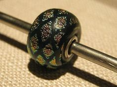 Authentic trollbeads very Rare  Harlequin TBM041