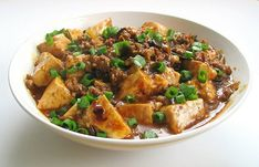 Mapo Tofu! You can sub the meat for boca and use vegetable stock   to have a truly veg dish.