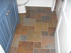 Pinwheel tile backsplash shows a stone backsplash for Vinegar on concrete floor