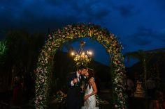 Flower arch framing bride & groom at Santiago wedding