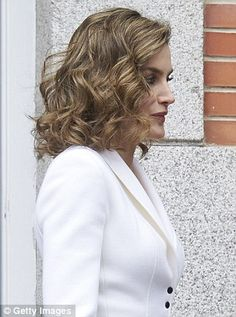 The Spanish Queen completed the coordinated look with a pair of black patent court shoes and wore her hair in a chic side parting with loose waves