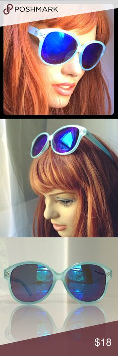"""Cat Eye Mirrored Sunglasses sky blue cobalt lenses Fabulous pastel sky blue frames with iridescent cobalt revo mirrored lenses. Frames measure 6"""" across / Lenses are 2.25"""" x 2.5"""" / temple is 4.5"""" to ear / bridge is approx 18mm. Please keep in mind, I shoot mirrored lenses against a white bounce board when possible, so you can see what they look like to others when you are out in the sun. Accessories Sunglasses"""