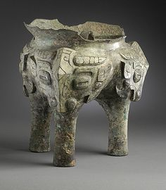 China  Fragment of a Ritual Grain Steamer (Yan) with Masks, Late Shang dynasty, late Anyang phase, or early Western Zhou dynasty, about 1100-950 B.C.  Metalwork; bronze, Cast bronze