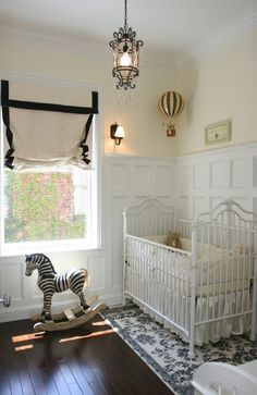 Gender Neutral Nursery: Board and batten, white iron crib, rocking zebra, dark wood flooring, hot air balloon hanging from ceiling. Could work as boy or girls nursery. Nursery Room, Girl Nursery, Chic Nursery, Nursery Ideas, Boy Room, Room Ideas, Nursery Curtains, Safari Nursery, Child's Room