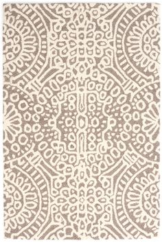 Dash & Albert | Temple Taupe Wool Micro Hooked Rug | Build a cozy and welcoming sanctuary with this micro-hooked wool rug. Featuring a pattern reminiscent of stained glass on a soothing neutral background, this area rug brings a bit of serenity and spirit to any space it inhabits.