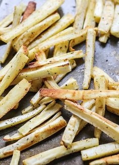 We're using a garlic infused coconut oil to make these healthy roasted parsnip fries! Just two ingredients plus some seasoning is all you need.