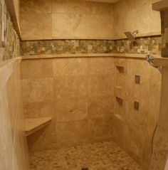 See more photos of Walk-In Stone Shower Room