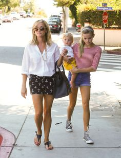 Preppy summer style, by the Witherspoons. Even the barefoot baby would look right at home in a J. Crew catalog.