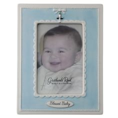 """Blessed Baby Blue Photo Frame. This """"Blessed Baby"""" frame presents a sweetly beaded border with pastel blue surrounding your little darling's picture. Atop the frame hangs a petite metal cross charm and a raised bow design. Perfect for a baptismal gift. $29.95  #CatholicCompany"""