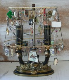 Lamp frame jewelry holder - This is such a neat idea and if the lamp still works...totally functional too!