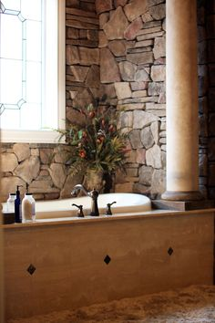 """Hockman's Bathroom Remodel , This bathroom was transformed into the """"Dream Bathroom."""" It includes a huge walk-in shower, a washer and dryer in the huge walk-in closet, the bathroom is even complete with a coffee bar!, The bathtub with the stone wall.   , Bathrooms Design"""