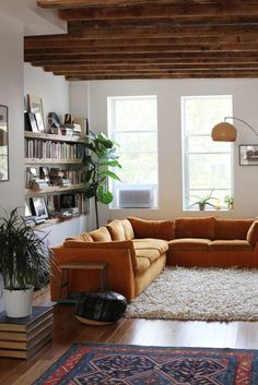 Just bought an orange sectional. Love this room!