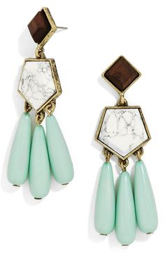 Adoring these statement drop earrings! They feature a distressed goldtone finish, hexagonal-shaped stones, and a trio of mint beads.