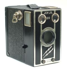 The Jem Jr. 120 is a simple metal box camera made in the 1940s by the Jem Camera Company division of the J.E. Mergott Company of Newark, NJ. The camera was available with or without flash capability, and there were a couple of Girl Scout versions as well.
