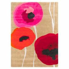 Pairing garden-inspired style with artful appeal, this hand-tufted wool rug showcases an painterly poppies motif.