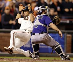 San Francisco Giants' Angel Pagan, left, slides to score past Colorado Rockies catcher Michael McKenry in the seventh inning of a baseball game Wednesday, Aug. 27, 2014, in San Francisco. Pagan scored on a single by Buster Posey. (AP Photo/Ben Margot)