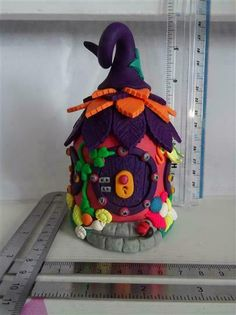 Hobbit House - Night Light (battery operated tea light) a purple, orange and multicolured polymer clay hobbit house with an internal glass jar as a base. Hobbit Door, The Hobbit, House Lift, Battery Operated Tea Lights, Ivy Leaf, Front Steps, Leaf Shapes, Glass Jars, Night Light