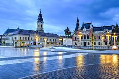Union square (Piata Unirii) seen at the blue hour in Oradea, Romania © Catalin Lazar / Shutterstock Capital Of Romania, 1. Mai, Fly Around The World, Visit Romania, Romania Travel, Most Beautiful Cities, Eastern Europe, Glasgow, Montana