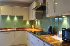 This kitchen's owner chose to arrange zebrano worktops with the detailed end grain on show. Solid Wood Worktops, Work Tops, Hardwood, Kitchen Cabinets, Modern, Gallery, Kitchens, Design, Home Decor