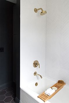 bathroom renovation // white subway tiles, Kohler gold shower and tub faucet Dream Bathrooms, Beautiful Bathrooms, Hotel Bathrooms, Bathroom Renovations, Home Renovation, Kitchen Remodeling, White Bathroom, Small Bathroom, Brass Bathroom