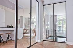 Hal met stalen deuren, Rubensstraat | Kodde Architecten