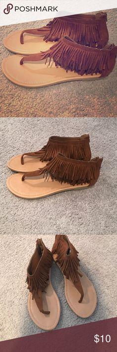 Brown fringe sandals Never worn brown fringe sandals. Zip up back. Size 8 (run a little big) Wet Seal Shoes Sandals