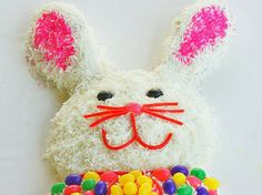Blogger Christy Denney of  The Girl Who Ate Everything shares a favorite recipe Bunny Surprise Cake. This bunny cake starts with a vanilla cake mix and is decorated to look like an Easter bunny with coconut and assorted candies. By adding some Easter colors to the batter a colorful surprise awaits when each slice of cake is served.