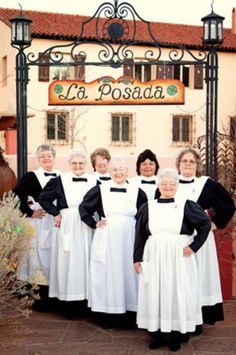 Winslow Harvey Girls are volunteers who give guided tours of La Posada Hotel while dressed in clothing.the costumes and ages of the waitresses have changed considerably! Harvey House, Harvey Girls, Staff Uniforms, Southwest Style, Bridesmaid Dresses, Wedding Dresses, Route 66, Volunteers, Santa Fe