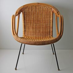 "Modern Rattan Chair, $358, now featured on Fab.  Strong, sturdy, and clean Arthur Umanoff-style rattan chair with black metal base and black wrought iron base. There are a couple of breaks on the wicker strand, which does not compromise the integrity of the chair. This gently used vintage product is in good condition. Shows some signs of age. Seat height: 16""."