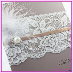 Vintage wedding invitation with feather and lace