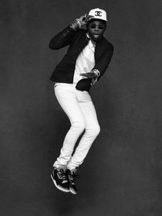 Theophilus London in Karl Lagerfeld and Carine Roitfeld's forthcoming book The Little Black Jacket: Chanel's Classic Revisited, features 112 tritone photographs of famous, beautiful people wearing the label's iconic cropped tweed. Shot by Lagerfeld, the crisp black and white images portray cultural figures.