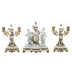 French Neoclassical  Sevres Bisque Three Piece Clock Garniture | From a unique collection of antique and modern garniture at https://www.1stdibs.com/furniture/dining-entertaining/garniture/
