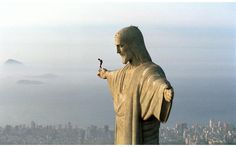 BASE JUMPING IN RIO  © Photograph by Wolfgang Luif/Red Bull Content Pool   In this heart-stopping photograph, we see Austrian athlete Felix Baumgartner atop the Christ the Redeemer statue in Rio de Janeiro, Brail. The photo shows Felix preparing to BASE jump the iconic statue back on December 3,2001. Cristo Redentor